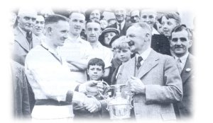 Tommy Lowe Snr receives the League Championship Trophy, 1939